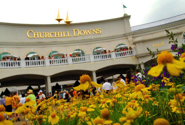 LOUISVILLE, KY - MAY 5:  Fans gather at the entrance to the 133rd running of the Kentucky Derby at Churchill Downs on May 5, 2007 in Louisville, Kentucky.  (Photo by Jeff Gentner/Getty Images)